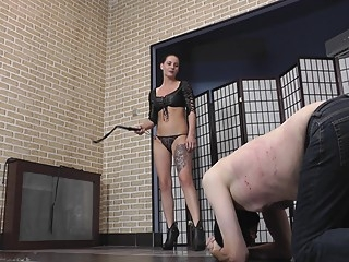 Hot brunette mistress in leather bra whipping her slave bdsm brunette femdom video