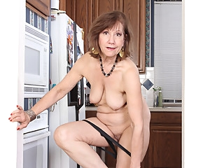 American gilf Penny gets busy in the kitchen grannies mature milf video