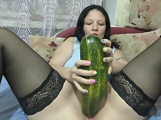 milf fucks herself with a bottle, zucchini and makes fisting. squirt amateur fisting milf video